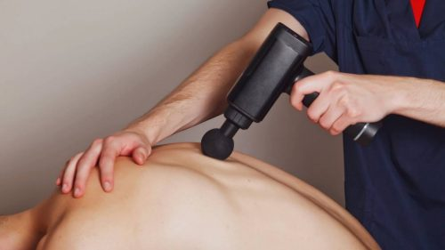 How to use a electric massager gun for back pain relief?