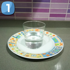 Step 1 Fill half a glass of water